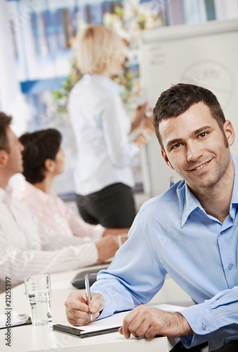 Businessman making notes on meeting