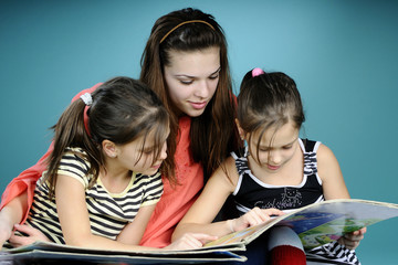twins and young educator reading