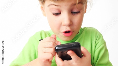 small girl play in communicator with stylus on white background