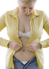 overweight woman trying to fasten too small  clothes