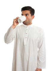 Arab ethnic man drinking coffee
