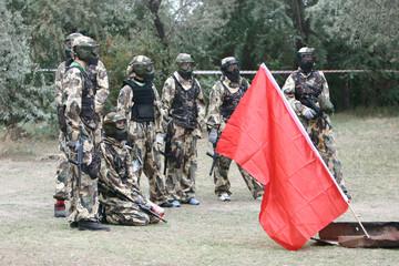 Paintball team with flag