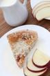 Slice of freshly baked rhubarb crumble with apple