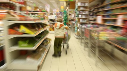 boy moving in supermarket, motion blurred video