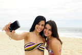 two women taking self-portrait with cellphone