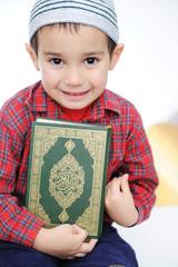 Muslim kid with holy book Koran
