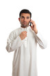 Thinking ethnic businessman on mobile phone