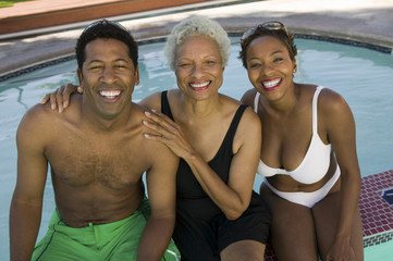 senior woman with couple at swimming pool elevated view portrait.