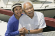 senior couple embracing in marina (portrait)