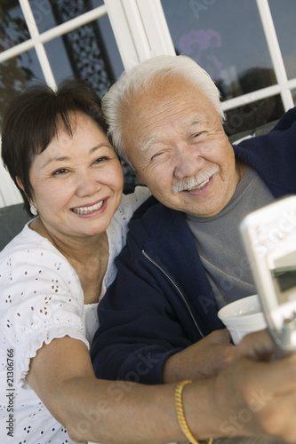 couple using mobile phone outdoors