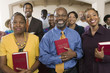 sunday service congregation standing in church with bibles portrait