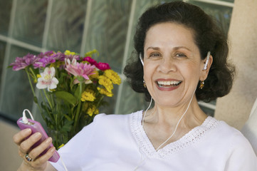 woman listening to music on mp3 player