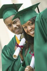 Graduates Holding Diplomas
