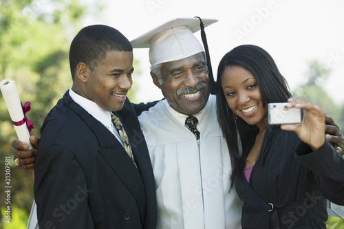 Family Taking Picture at Graduation with Cell Phone