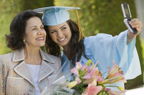 Graduate and Grandmother Taking Picture with Cell Phone