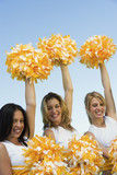 three cheerleaders rising pom-poms (portrait)