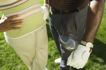 senior couple in golf course (mid section) (elevated view)
