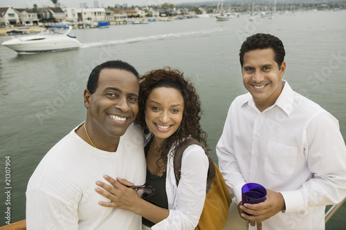 couple with friend on yacht (portrait) (elevated view)
