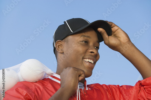 ball boy ajusting hat in softball game