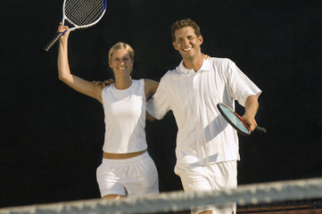 tennis partners skipping side by side arms around celebrating victory