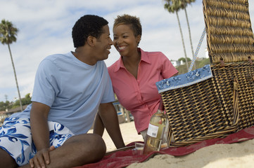 couple having picnic at beach