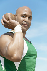 shot putter holding shot put half-length
