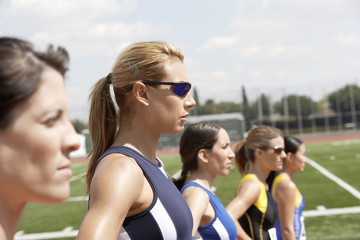 female athletes lining up to start race head and shoulders