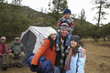 family with children (7-12) camping (portrait)