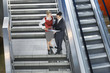 businessman and businesswoman conversing on stairs elevated view