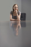businesswoman sitting at conference table