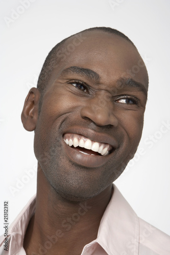 smiling man with squinty eyes close-up