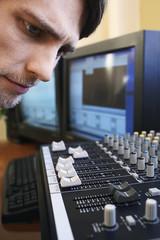 man looking at mixer close-up.