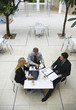 three businesspeople working outdoors elevated view