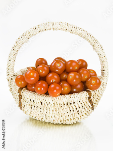 Fifty cherry tomatoes in a basket