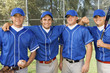 four baseball team-mates posing on field (portrait)