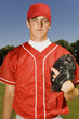 baseball pitcher holding glove (portrait)
