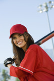 young woman with softball bat portrait