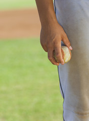baseball pitcher holding ball (close-up) (mid section)