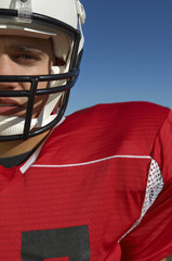 football player wearing helmet close-up portrait cropped (close-up) (portrait)