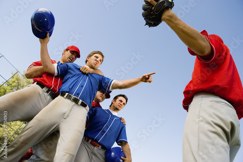 baseball players arguing on field (low angle view)