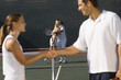 tennis players shaking hands at net side view