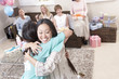 woman hugging at baby shower