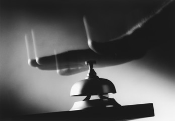 hand hitting service bell (b&w) (close-up)