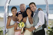 bride and groom with family at beach wedding (portrait)