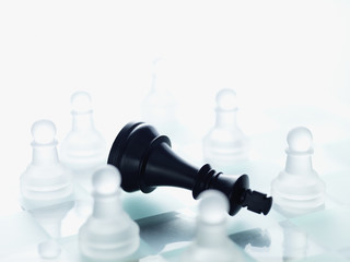 Black and glass chess pieces