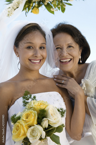 bride and mother with bouquet outdoors (portrait)