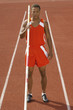 male athlete with pole vault on running track