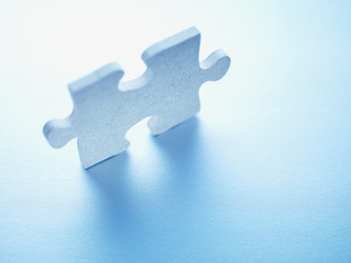 Jigsaw puzzle piece standing on end