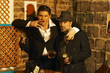 2 retro gangsters posing