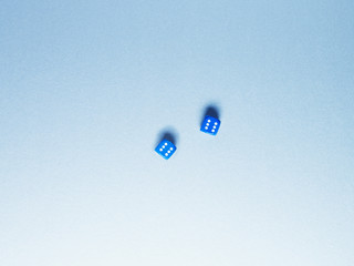 Directly above two blue dice